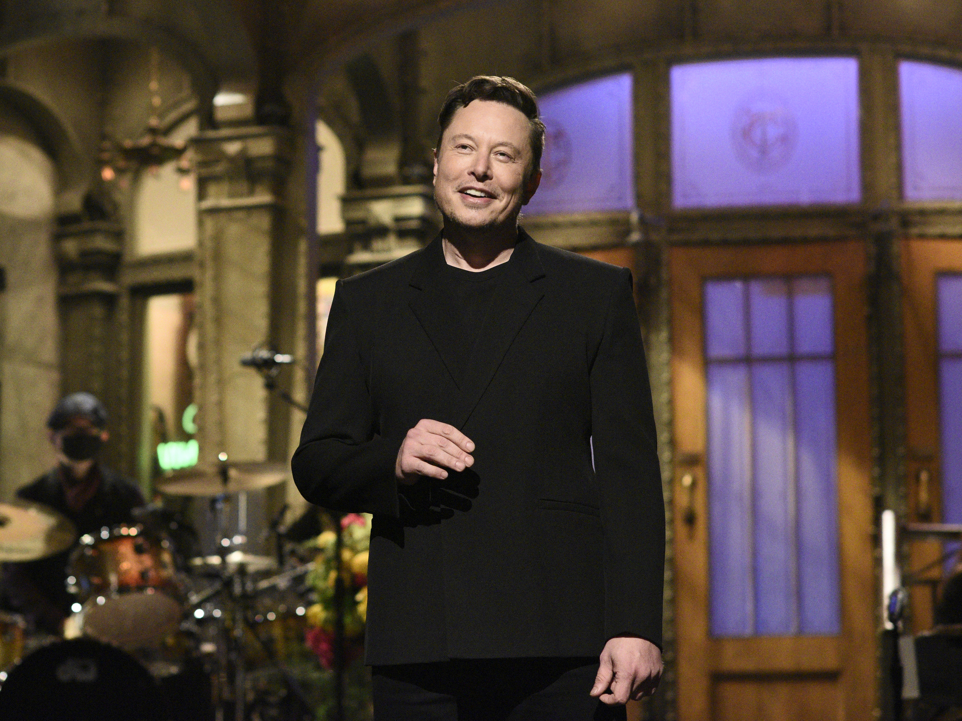 """Tesla CEO Elon Musk delivers his opening monologue on """"Saturday Night Live"""" last week in an image released by NBC. Musk tweeted on Wednesday that Tesla would no longer accept cryptocurrency Bitcoin for car purchases."""