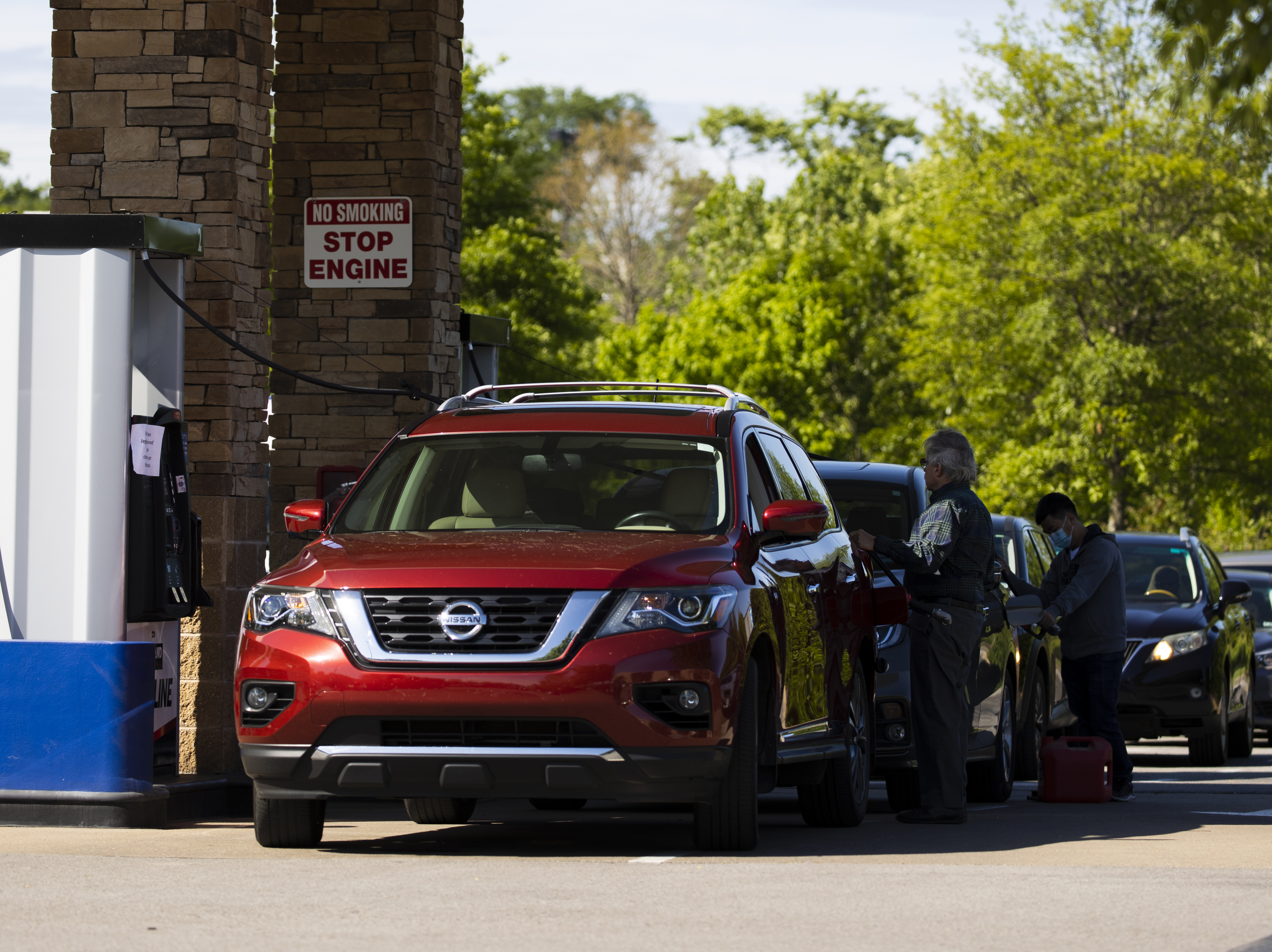 Customers wait in line to fill up their tanks this week at a Costco gas station in Nashville, Tenn. It will take several days for the supply chain of fuel to return to normal even after Colonial Pipeline said it had brought its entire pipeline system back into operation.