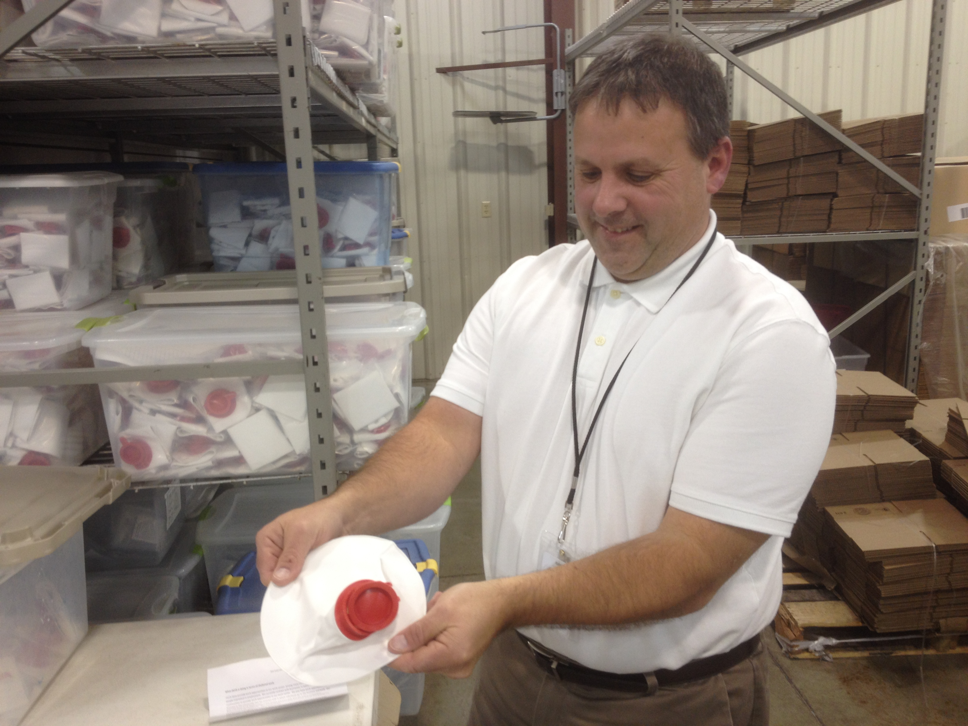 Occupational Center of Central Kansas Regional Manager James Quillen displays an ice bag made by OCCK clients. (Photo by Bryan Thompson)