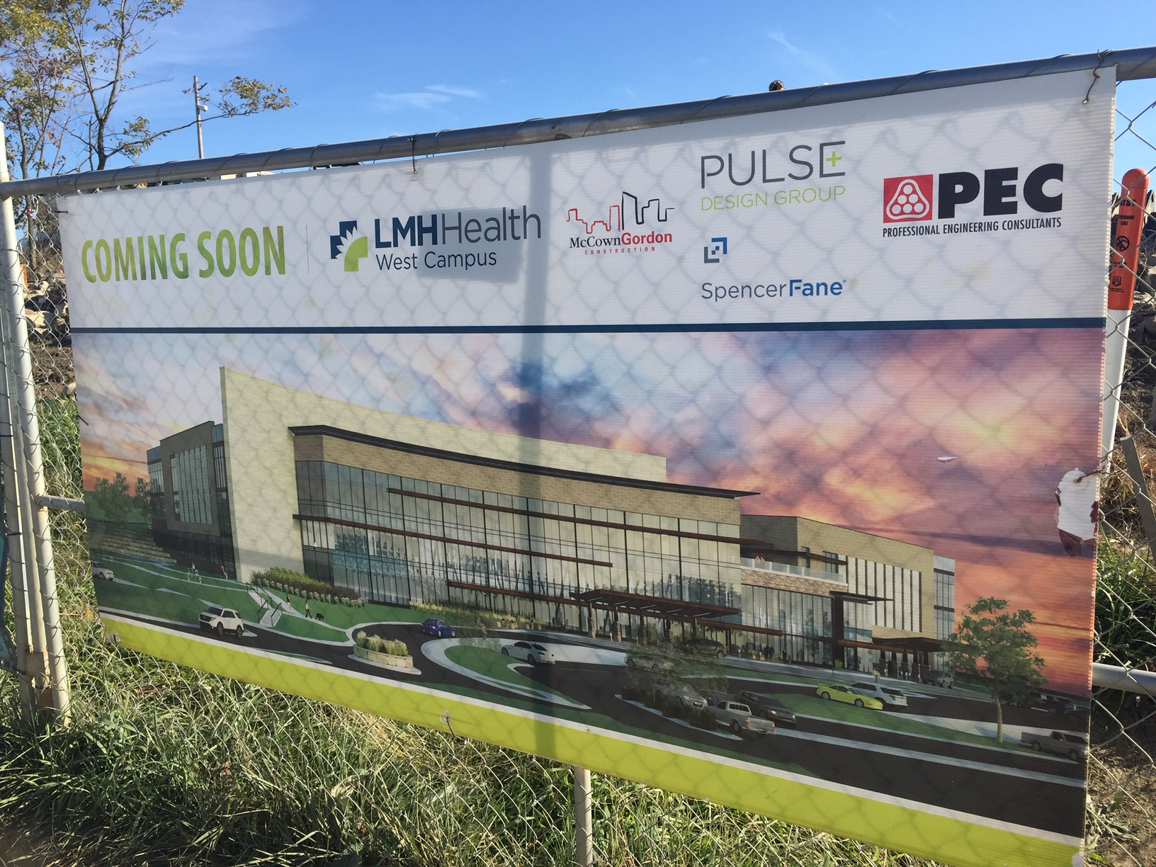 This poster, on a construction fence, depicts what the LMH Health West Campus will look like when completed.  The outpatient facility is part of the hospital's $100 million expansion plan. (Photo by J. Schafer)