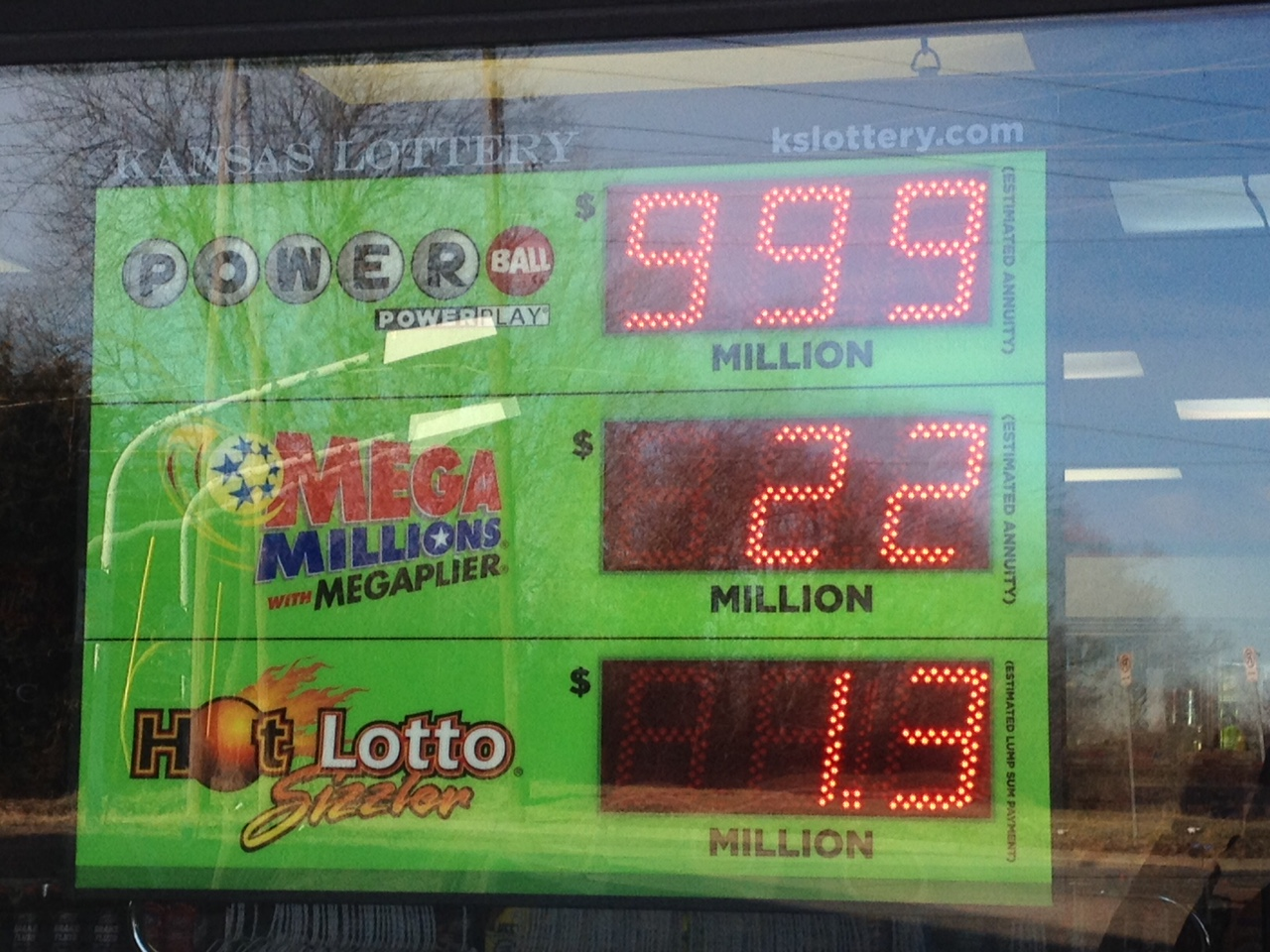 At $1.5 billion, the Powerball jackpot is now so large that it can't be accurately reflected on this lottery retailer's sign, which only goes up to $999 million. (Photo by J. Schafer)