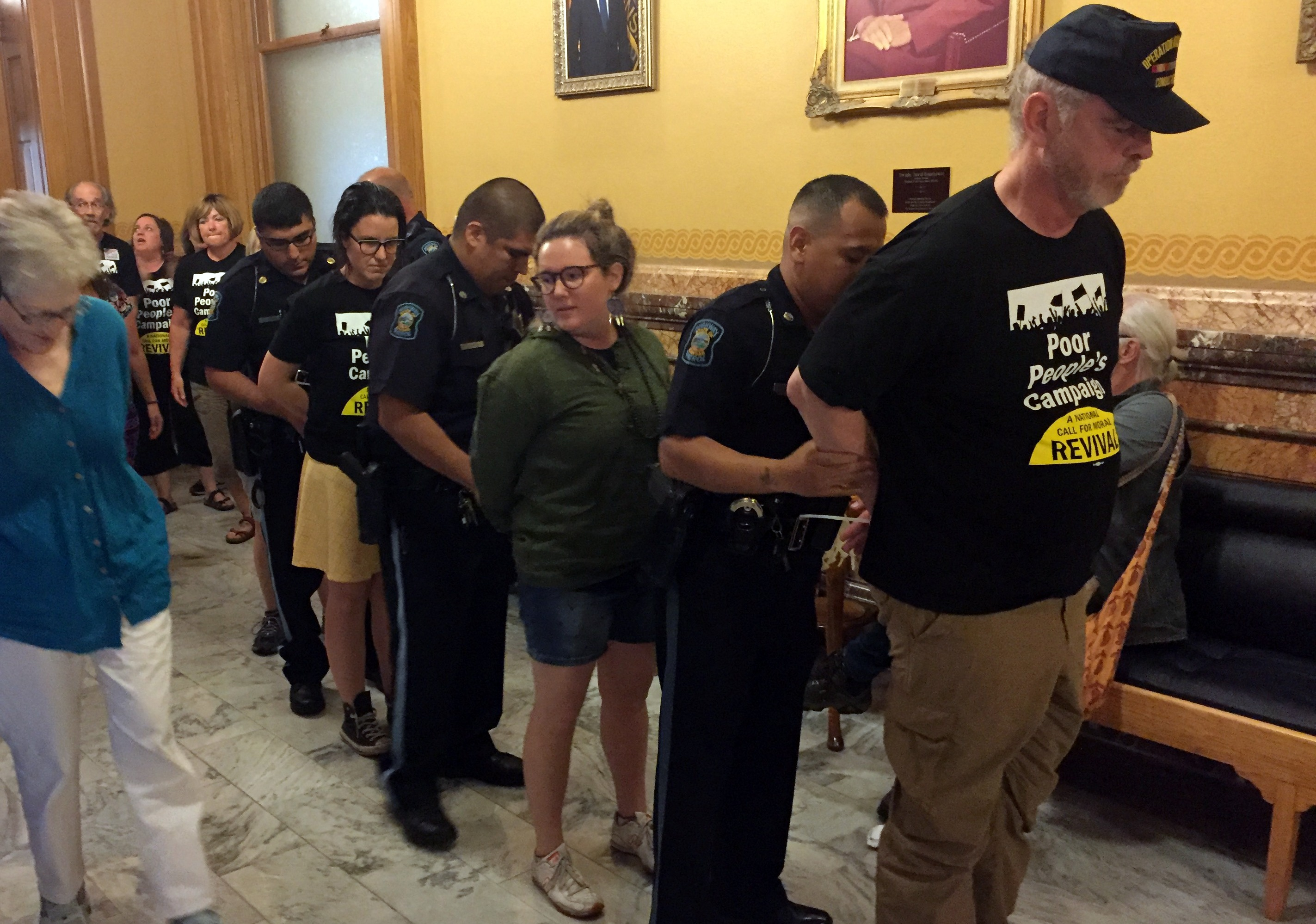 Police arrest protesters outside the governor's office. (Photo by Stephen Koranda)
