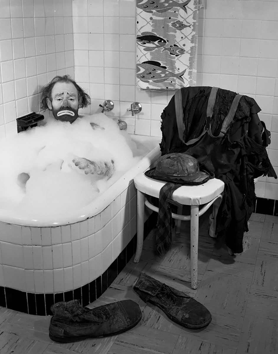 Ringling Circus clown Emmett Kelly in a bubble bath: Sarasota, Florida Date: ca. 1955 (Photo via Wikimedia)