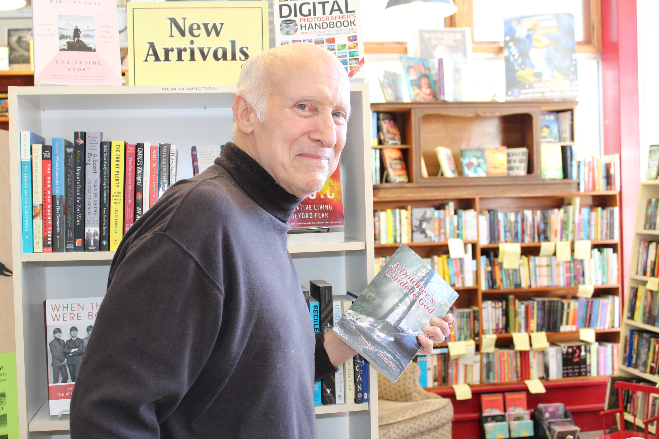 Lawrence writer Roger Martin attempts to shoplift one of his own books at the Raven Book Store in downtown Lawrence. Just kidding. (Photo by J. Schafer)