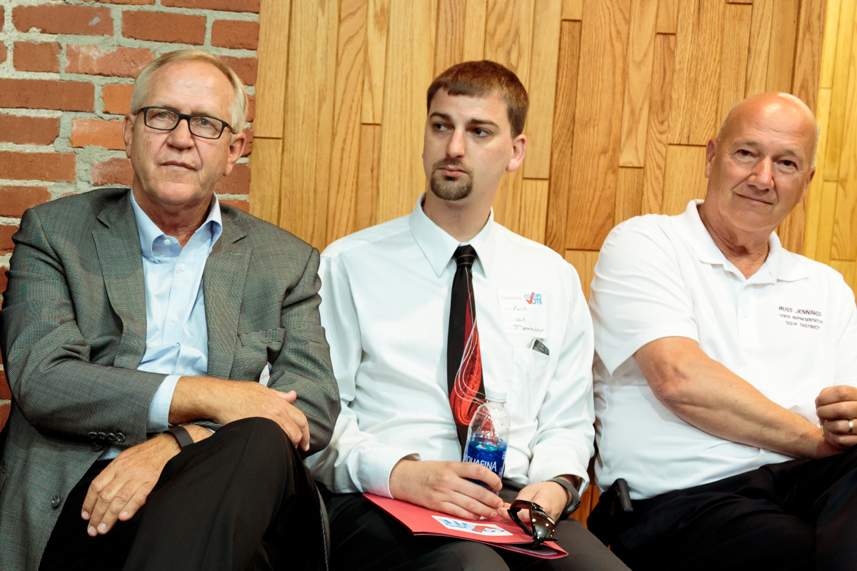 Rep. Russ Jennings (far right), with Kansas Senate 39 candidates Republican John Doll (far left) and Democrat Zach Worf, at a candidate forum in Garden City ahead of the August primaries. Jennings was unopposed both for the primary and the general election. (Photo by Amy Jeffries)