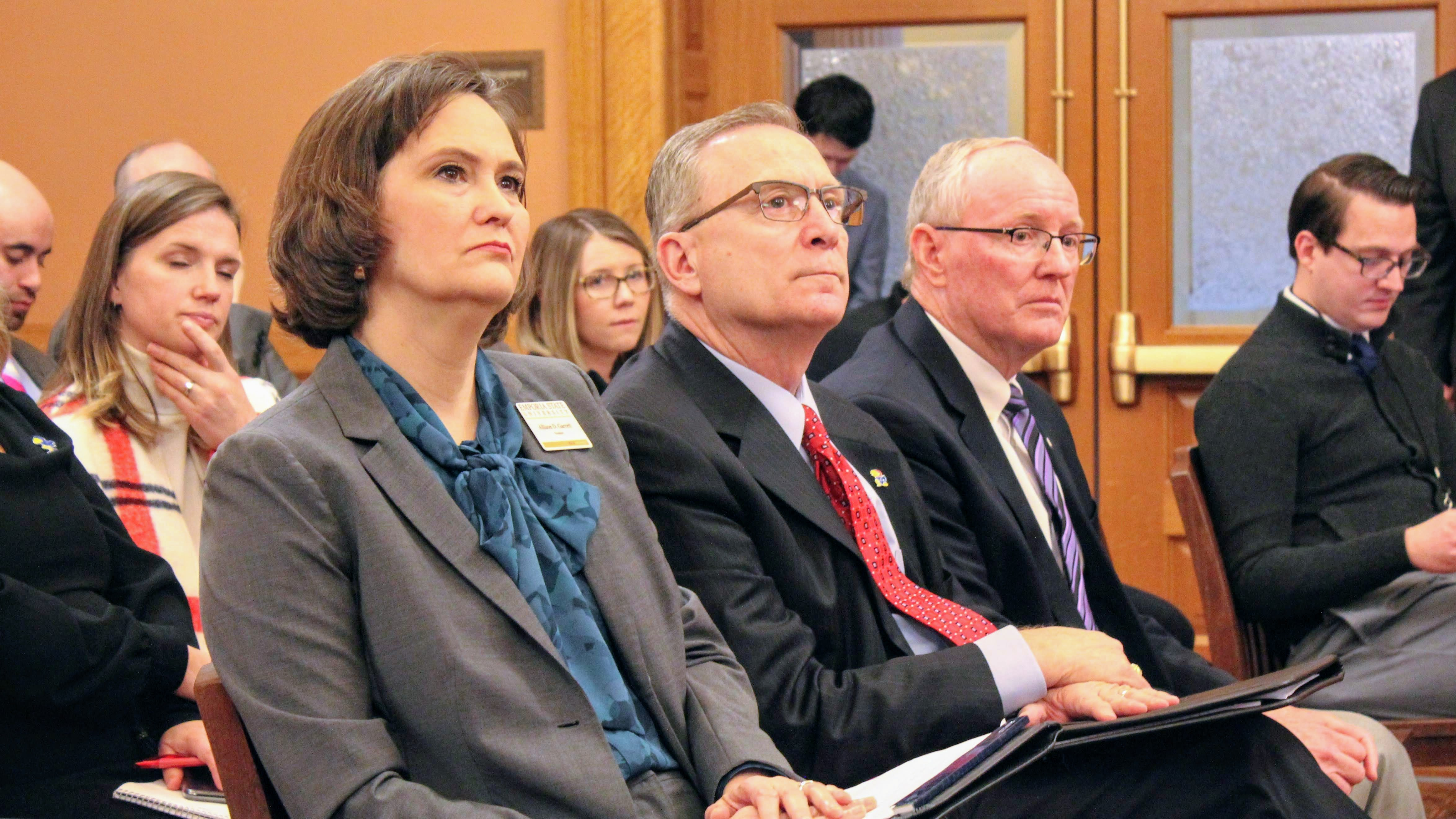 Emporia State University President Allison Garrett (left), KU Director of Athletics Jeff Long (center) and Kansas State Athletics Director Gene Taylor testified in support of a bill that would allow student-athletes to be paid for endorsements. (Photo by Stephen Koranda, Kansas News Service)