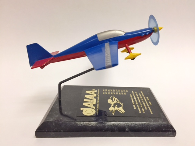 "A model of the ""Screamin' Dingo,"" a proposed aircraft designed by KU aerospace engineering students.  Their design took top honors in an international aircraft design competition. (Photo by J. Schafer)"