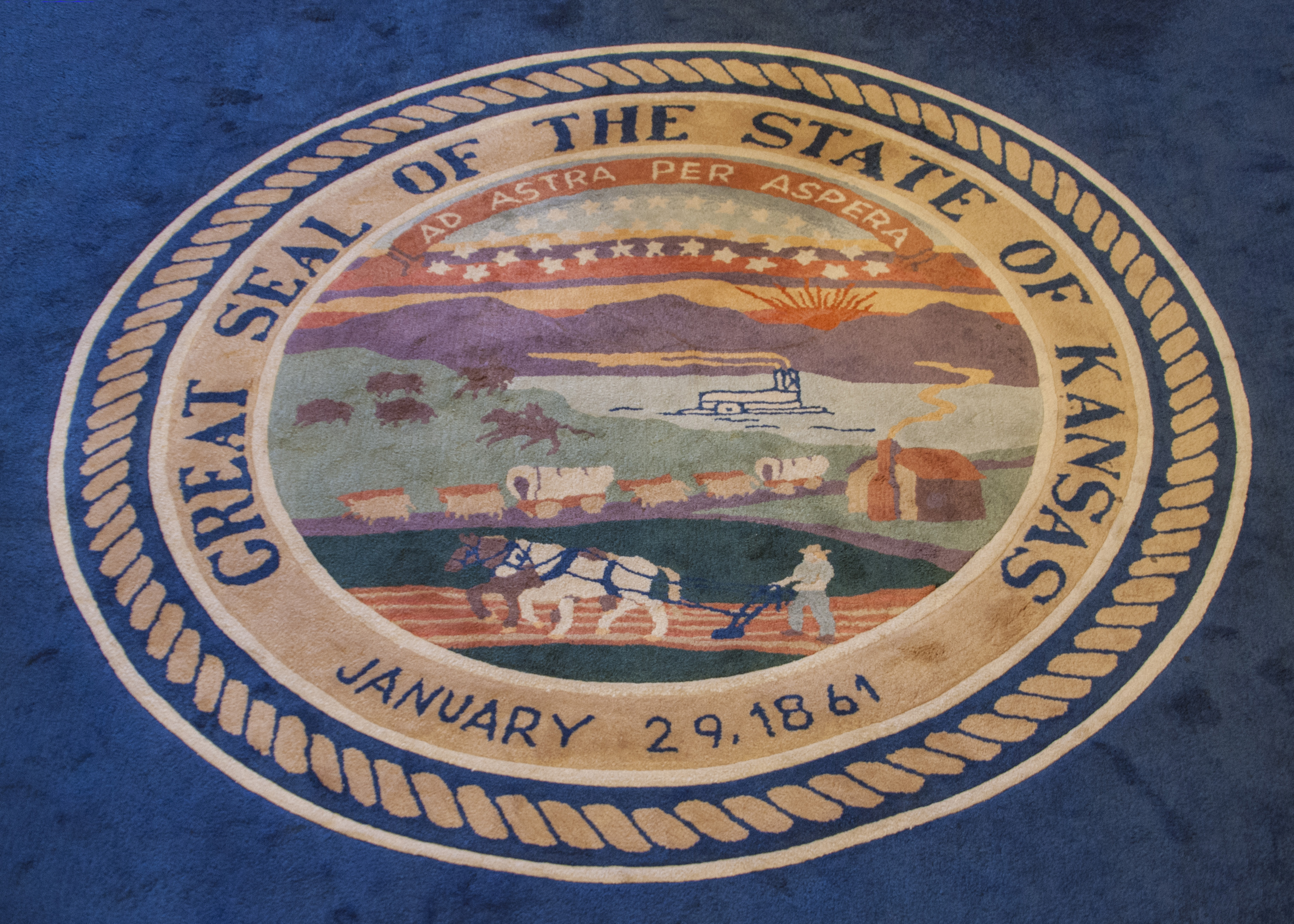 Great seal of the great State of Kansas, as depicted in this rug inside the governor's office at the Kansas Statehouse. (Photo by Dan Skinner)