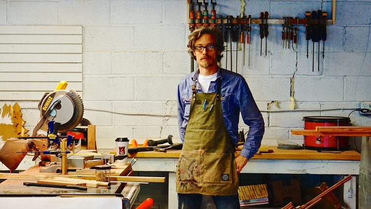 """Shine Adams, the CEO of Sun Cedar, ready to do some woodworking (Photo courtesy <a href=""""http://www.sun-cedar.com"""">www.sun-cedar.com</a>)"""