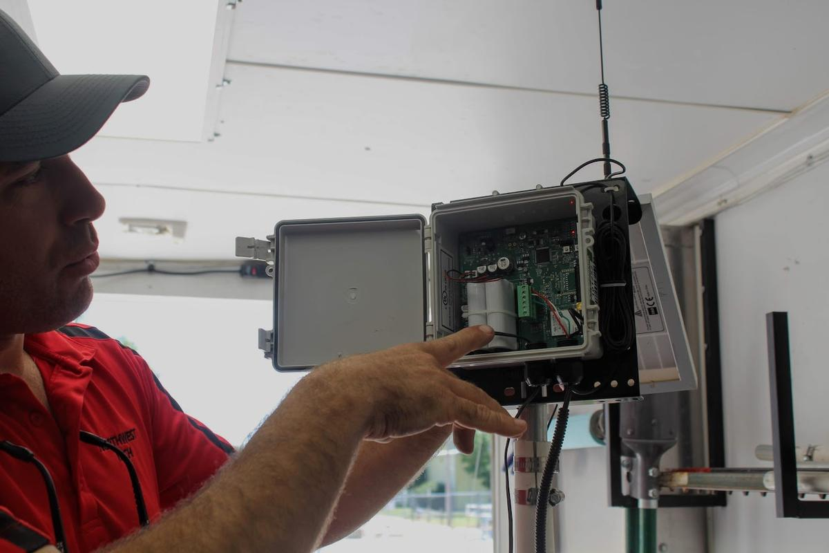 Weston McCary, a precision agriculture technology instructor at Northwest Kansas Technical College, holds a soil monitoring device. (photo credit: Corinne Boyer/Kansas News Service)