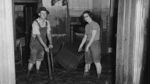 Cleaning up a residence after the 1951 flood in Topeka, Kansas (July 19, 1951). (Photo Courtesy of Kansas Historical Society / kansasmemory.org)