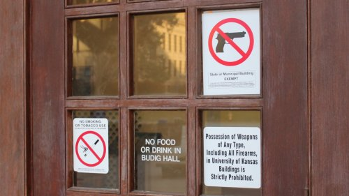 A door at the University of Kansas with a sign barring guns. (Photo by Stephen Koranda)