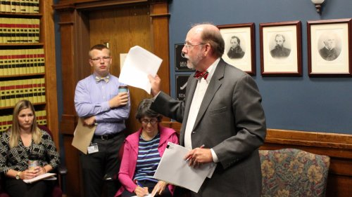 Mark Johnson speaking against the new voter registration rule at a meeting earlier this month. (Photo by Stephen Koranda)