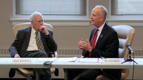 Senator Jerry Moran speaking while Board of Education Chairman Jim Porter listens. (Photo by Stephen Koranda)
