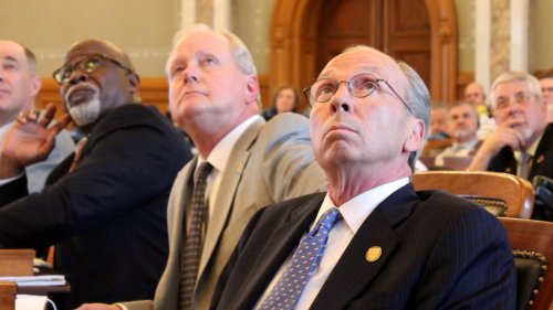 Republican lawmakers watch a board displaying the vote count. (Photo by Stephen Koranda)