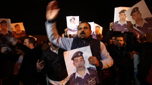 Relatives of Jordanian pilot Lt. Muath al-Kaseasbeh, who was captured by ISIS militants in Syria, protest in front of royal palace in Amman, Jordan, Tuesday. Jordan has suggested it might be willing to hold a prisoner exchange for his release.