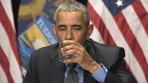 President Obama drinks a glass of filtered Flint water during a meeting with federal officials at the Food Bank of Eastern Michigan in Flint, Mich., on Wednesday.