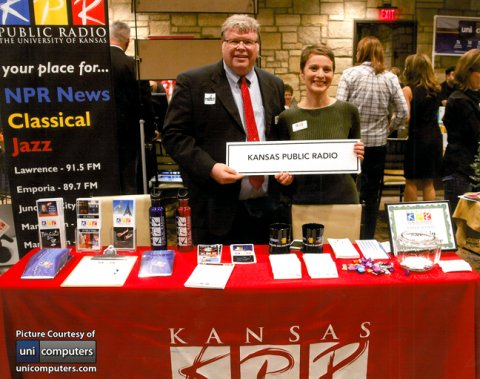Feloniz Lovato-Winston, right, and Phil Wilke, KPR Media Manager, greeted customers at a Lawrence Chamber of Commerce mixer.