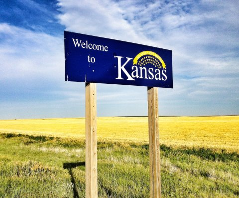 This is a real Kansas highway sign, welcoming motorists to the real state of Kansas. (Photo by 5th-generation Kansan, J. Schafer)