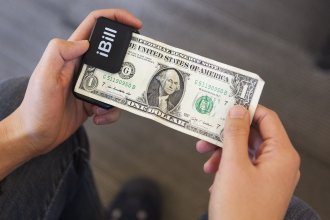 """After scanning a $1 bill with iBill, a speaker announces, """"one dollar."""""""