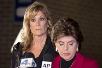 Judy Huth, left, appears at a news conference with attorney Gloria Allred outside the Los Angeles Police Department's Wilshire Division station on Friday. Huth says that in 1974 as a 15-year-old she was drugged and raped by comedian Bill Cosby.