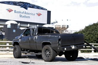 A truck driven by Carolina Panthers quarterback Cam Newton sits near Bank of America Stadium after the quarterback was involved in an accident Tuesday.