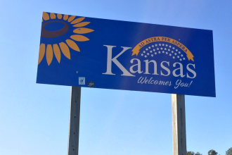 This welcome sign along the border greets motorists from southwest Missouri as they enter Crawford County, in southeast Kansas. (Photo by J. Schafer)