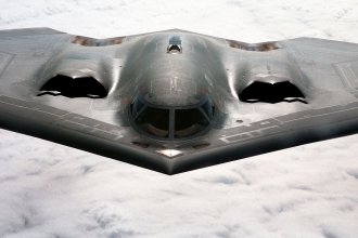 The B-2 Spirit bomber is a blending of low-observable technologies with high aerodynamic efficiency and large payload that gives the B-2 important advantages over existing bombers. Its unrefueled range is approximately 6,000 nautical miles. (U.S. Air Force photo by Staff Sgt. Mark Olsen)