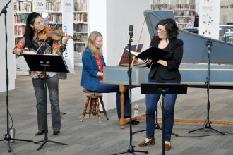 The Bach Aria Soloists perform in the Lawrence Public Library atrium.