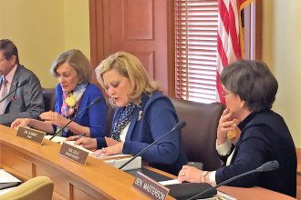 A Kansas Senate committee on Thursday advanced a Medicaid expansion bill, sending it to the full Senate for a vote next week.  Members of the committee include, from left, Barbara Bollier, Vicki Schmidt and Laura Kelly.  (Photo by Jim McLean)