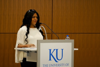 Kavitha Davidson at KU podium
