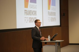 Photo of Secretary Toland provided by KU School of Business