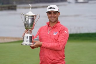 Topeka native Gary Woodland, holding U.S. Open trophy at Pebble Beach, California, Sunday afternoon.  (Photo from AP)