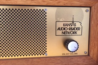 One of the special radios capable of hearing broadcasts from the Kansas Audio Reader Network, at the University of Kansas. (Photo by J. Schafer)