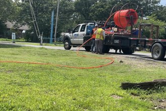 Workers at Lake Region Electric Cooperative install fiber optic in Hulbert, Oklahoma. (Photo: Seth Bodine, Harvest Pubic Media)