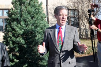 Governor Brownback speaking outside the governor's mansion Tuesday. (Photo by Stephen Koranda)