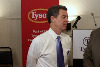 Governor Brownback at an event unveiling the now-stalled Tyson plant proposal. (Photo by Stephen Koranda)