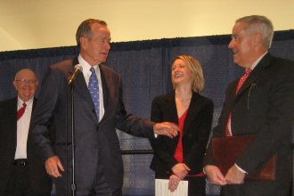President George H.W. Bush with KU Chancellor Robert Hemenway and Dole Institute Director Bill Lacy (photo from Dole Institute)