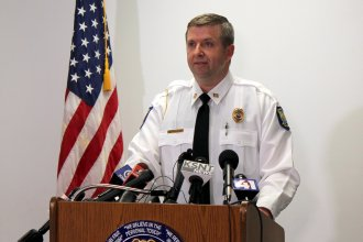 Lawrence Police Captain Adam Heffley speaking to reporters. (Photo by Stephen Koranda)