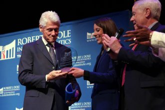 Clinton accepting the Dole Leadership Prize. (Photo from the University of Kansas)