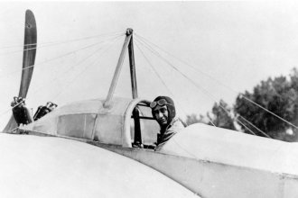 Clyde Cessna sitting in the cockpit of an early monoplane (Photo from the Kansas Historical Society)