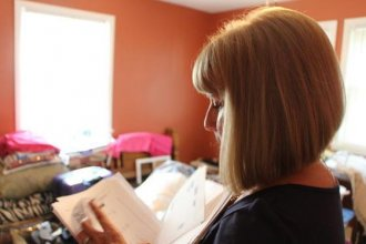 Judy Conway waited more than a year after the death of her grandson, Adrian Jones, to get 2,000 redacted pages from the Kansas Department for Children and Families. (Photo by Madeline Fox / Kansas News Service)