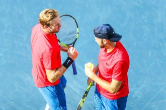 Brothers Eric (L) and Jack Sock (R) prepare for doubles match. (Photo by Greg Echlin)