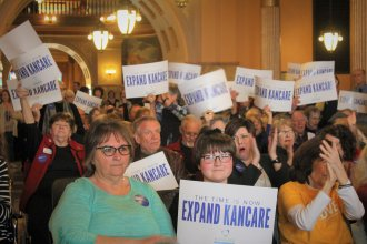 A demonstration at the Kansas Statehouse came earlier this week, before the House voted to expand Medicaid coverage in the state. (Photo Credit: Jim McLean, Kansas News Service)