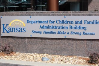 The outside of the Kansas state agency that handles the foster care system, among other things. (Photo by Madeline Fox, Kansas News Service)