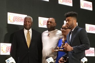 Frank Mason III poses with his parents (Frank Mason II and Sharon Harrison) and Naismith Basketball Hall of Famer Oscar Robertson after the KU player was awarded the Oscar Robertson trophy as the USBWA (U.S Basketball Writers Assn.) Player of the Year.  (Photo by Greg Echlin)
