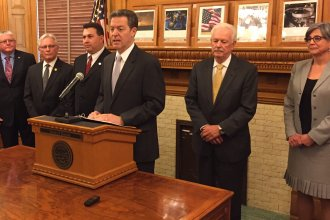 Governor Brownback and lawmakers unveil the compromise. (Photo by Stephen Koranda)