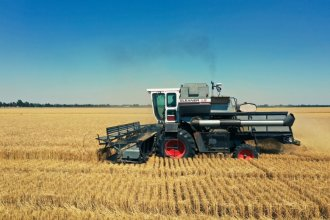 A combine harvests wheat near Mount Hope in Sedgwick County. (Photo by Andrew Tade, Special To KMUW)