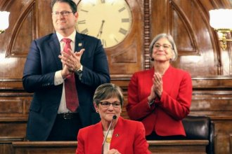 Governor Laura Kelly delivers her first State of the State speech, flanked by Republicans House Speaker Ron Ryckman and Senate President Susan Wagle. (Photo by Jim McLean / Kansas News Service)