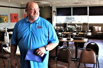 Scott Albrecht surveys his empty Topeka restaurant after closing because of the coronavirus. (Photo by Jim McLean, Kansas News Service)